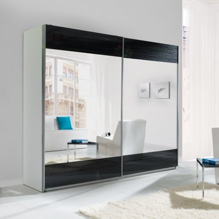 Cabinet with a mirror and black additives