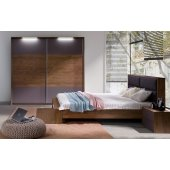 Bedroom with lighting and soft headboard